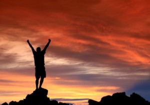 Success-Man_on_mountain-iStock_000003635594XSmall-300x211
